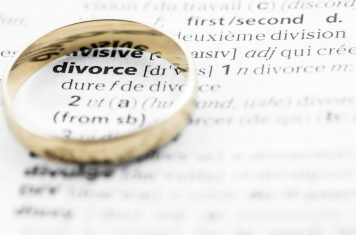 Divorce definition text with gold wedding ring concept